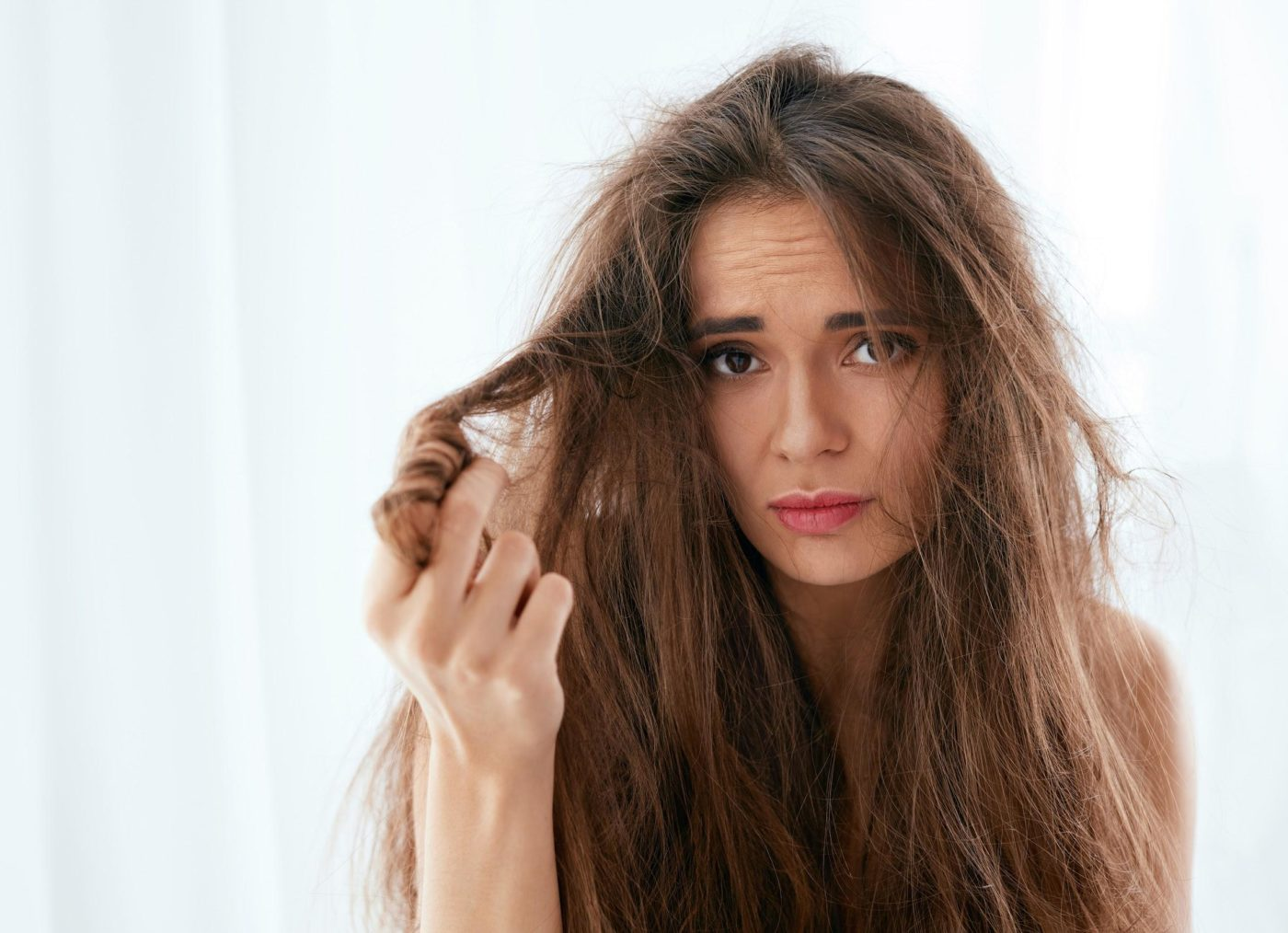 Woman With Dry And Damaged Long Hair